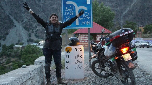 Guliafshan Tariq, a Pakistani athlete and activist, expresses jubilation over reaching Mirkhani, Chitral District, Khyber Pakhtunkhwa (KP), May 9 during the first leg of her solo motorbike ride. Tariq crossed KP to spread the message of peace and to promote a softer image of Pakistan. [Courtesy of Umbrella Brands Organisation]
