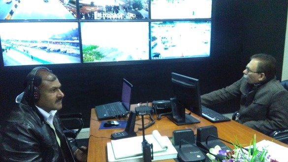 Officials at the Police Integrated Command, Control and Communication (IC3) centre in Islamabad monitor surveillance cameras in January. [Amna Nasir Jamal]
