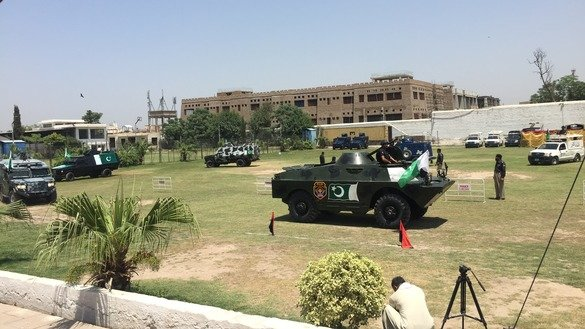 Armoured personnel carriers (APCs) and bulletproof patrol vans move from Malik Saad Shaheed Police Lines to various parts of Peshawar May 24. Workers recently repaired 6 APCs, increasing the fleet to 14, and added armour plating to 61 patrol vans. [Javed Khan]