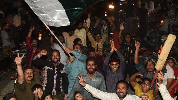Pakistani cricket fans in Lahore celebrate winning the International Cricket Championship (ICC) Champions Trophy final against India June 18. Pakistan thrashed the title-holders by 180 runs to win the Champions Trophy in London. [Arif Ali/AFP]