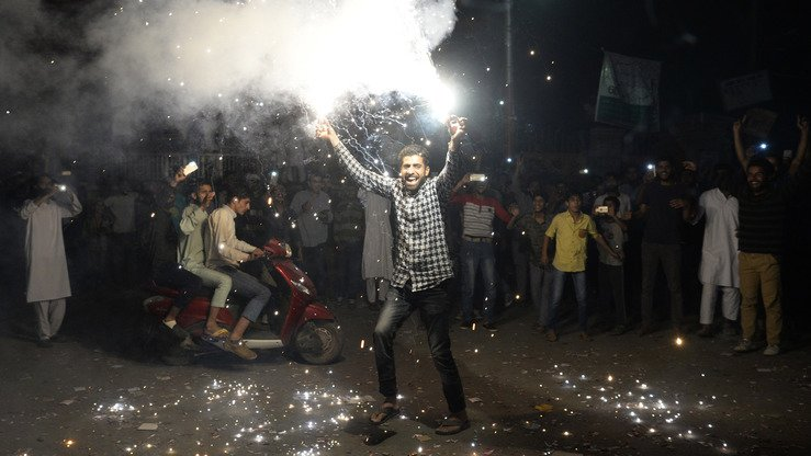 Pakistani cricket fans June 18 in Srinagar celebrate their team's ICC Champions Trophy. Shooting into the air injured at least 33 residents of Khyber Pakhtunkhwa (KP). Police have launched awareness campaigns to discourage the dangerous practice and made 66 arrests in Peshawar after the June 18 incidents. [Tauseef Mustafa/AFP]