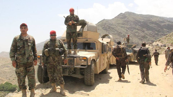 Afghan troops June 19 in Tora Bora review their progress after defeating the 'Islamic State of Iraq and Syria' (ISIS) in the strategic location. [Courtesy of Nangarhar provincial government press office]