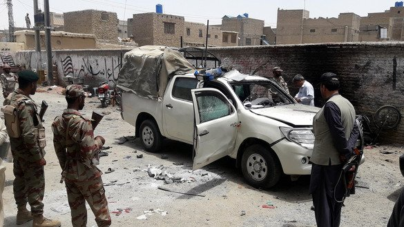 Pakistani security personnel inspect a vehicle at the site of a bomb that targeted police in Chaman, Balochistan Province, July 10. The blast killed the district police officer and his guard and wounded 11 others, according to local officials. [Asghar Achakzai/AFP]