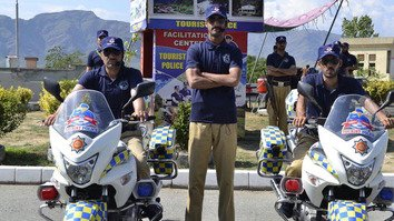 Tourist Police in Swat pose for a photograph on June 28. The 50-member force is dedicated to assisting and protecting tourists. [Javed Khan]