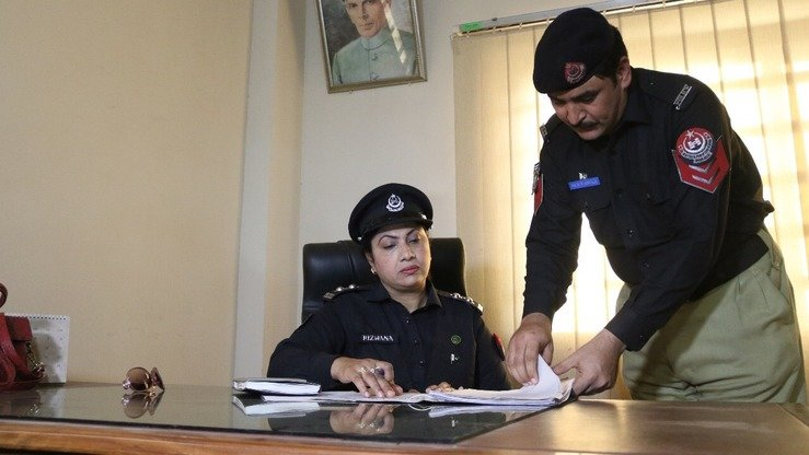 Rizwana Hameed assumes her duties at the Gulberg police station in Peshawar July 7. She became Khyber Pakhtunkhwa's first ever female station house officer in an all-male police station that week. [Javed Khan]