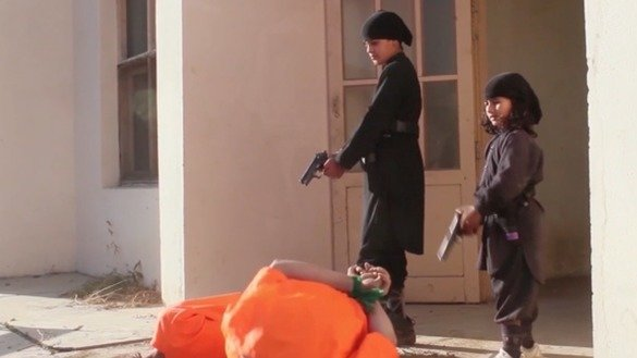 Two boys, believed to be between the ages of 7 and 12, are shown executing two other children in a propaganda video released by the 'Islamic State of Iraq and Syria' (ISIS) Khorasan branch. [FILE]