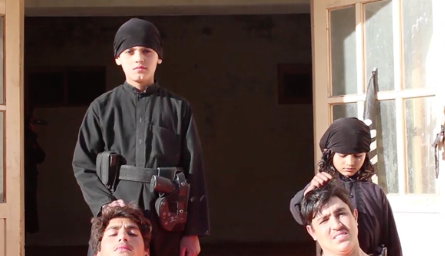 Two child members of ISIS are shown in the video preparing for executions. ISIS elements kidnap or recruit children through brute force and fear with the intention of brainwashing and training them to carry out executions, suicide bombing and other terrorist acts, observers say. [FILE]