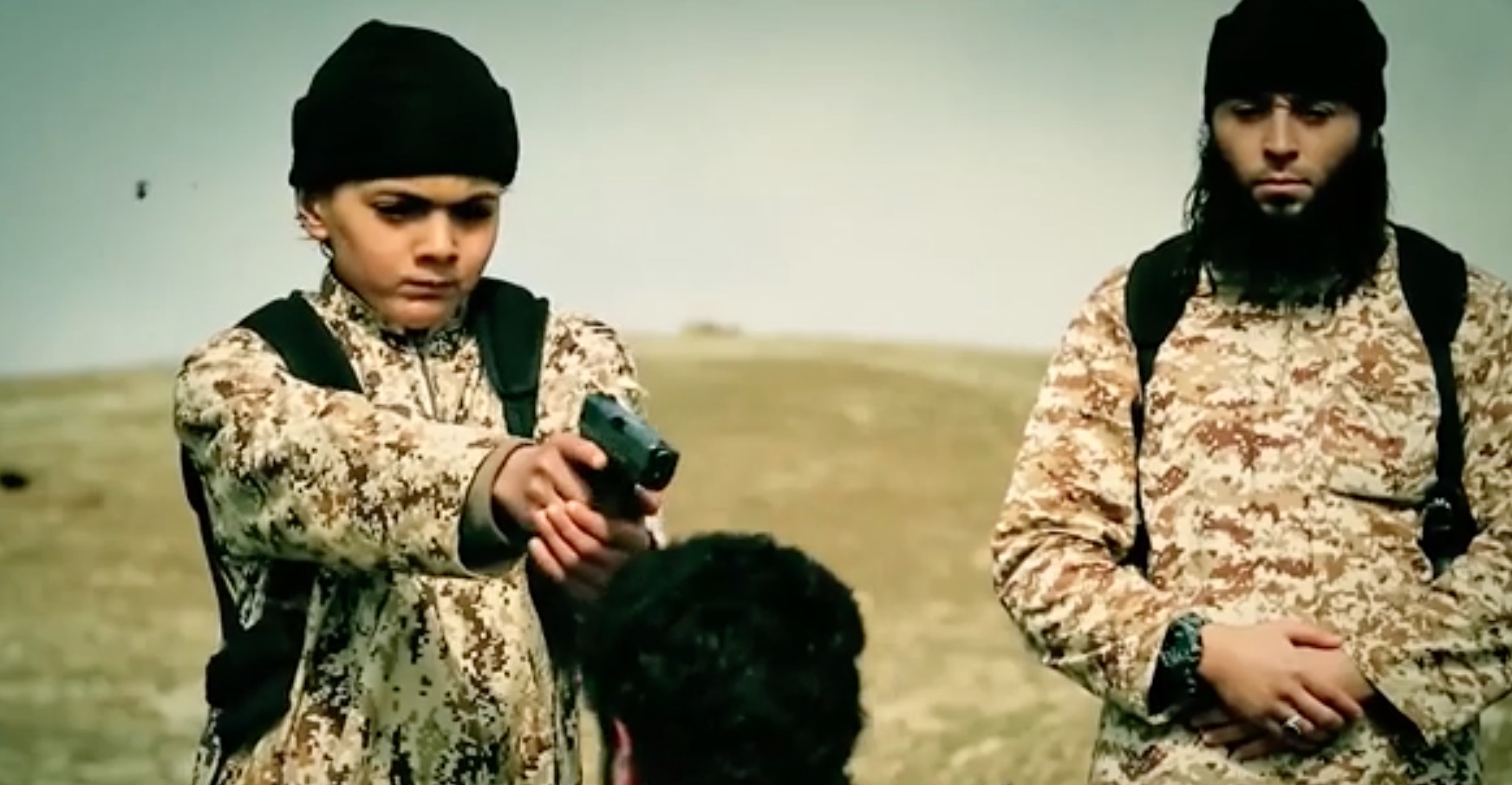 The 10-minute ISIS propaganda video includes a number of scenes of children brandishing handguns and shooting ISIS prisoners. [FILE]
