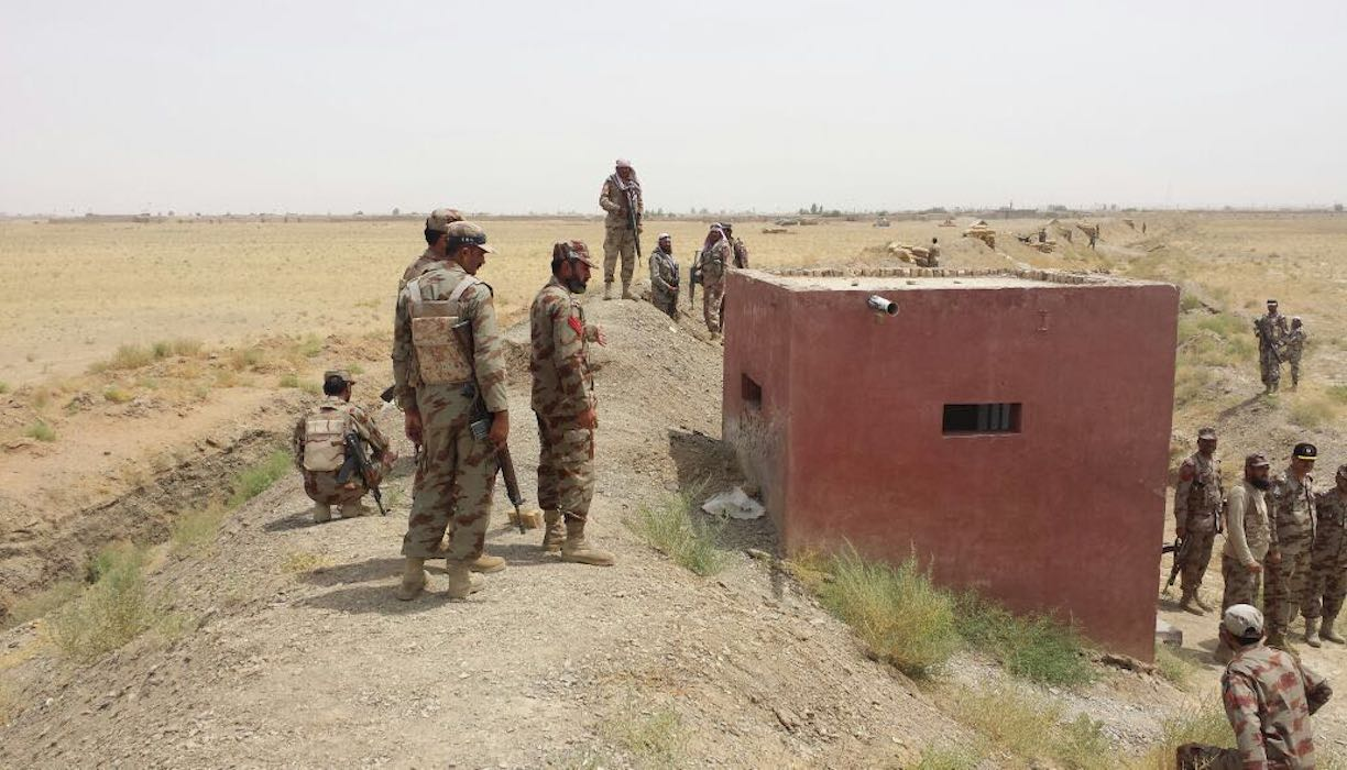 Security personnel July 17 inspect the Pakistani-Afghan border near Chaman. [Abdul Ghani Kakar]
