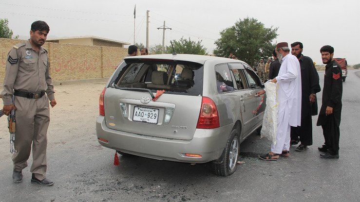 Pakistani security personnel inspect a bullet-riddled vehicle belonging to a Shia Muslim family after an ambush by gunmen on a highway in Choto, Balochistan Province, July 19. The gunmen killed four family members in what police called a sectarian attack. [STR/AFP]