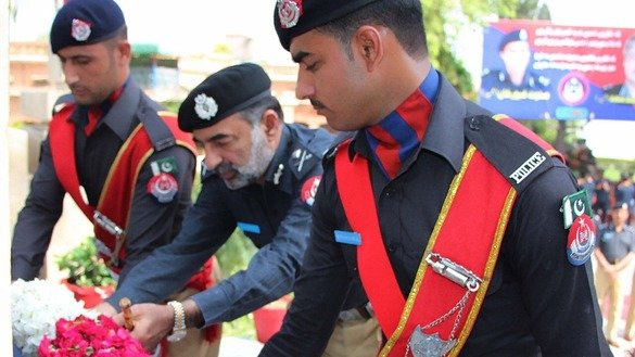 KP Inspector General of Police Salahuddin Khan Mehsud (centre) lays a floral wreath on the monument of martyrs at Malik Saad Shaheed Police Lines in Peshawar on the occasion of Police Martyrs Day August 4, 2017. [Courtesy of Khyber Pakhtunkhwa Police]