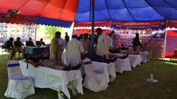 Dera Ismail Khan police officers donate blood as part of Police Martyrs Week July 31. [Javed Khan]