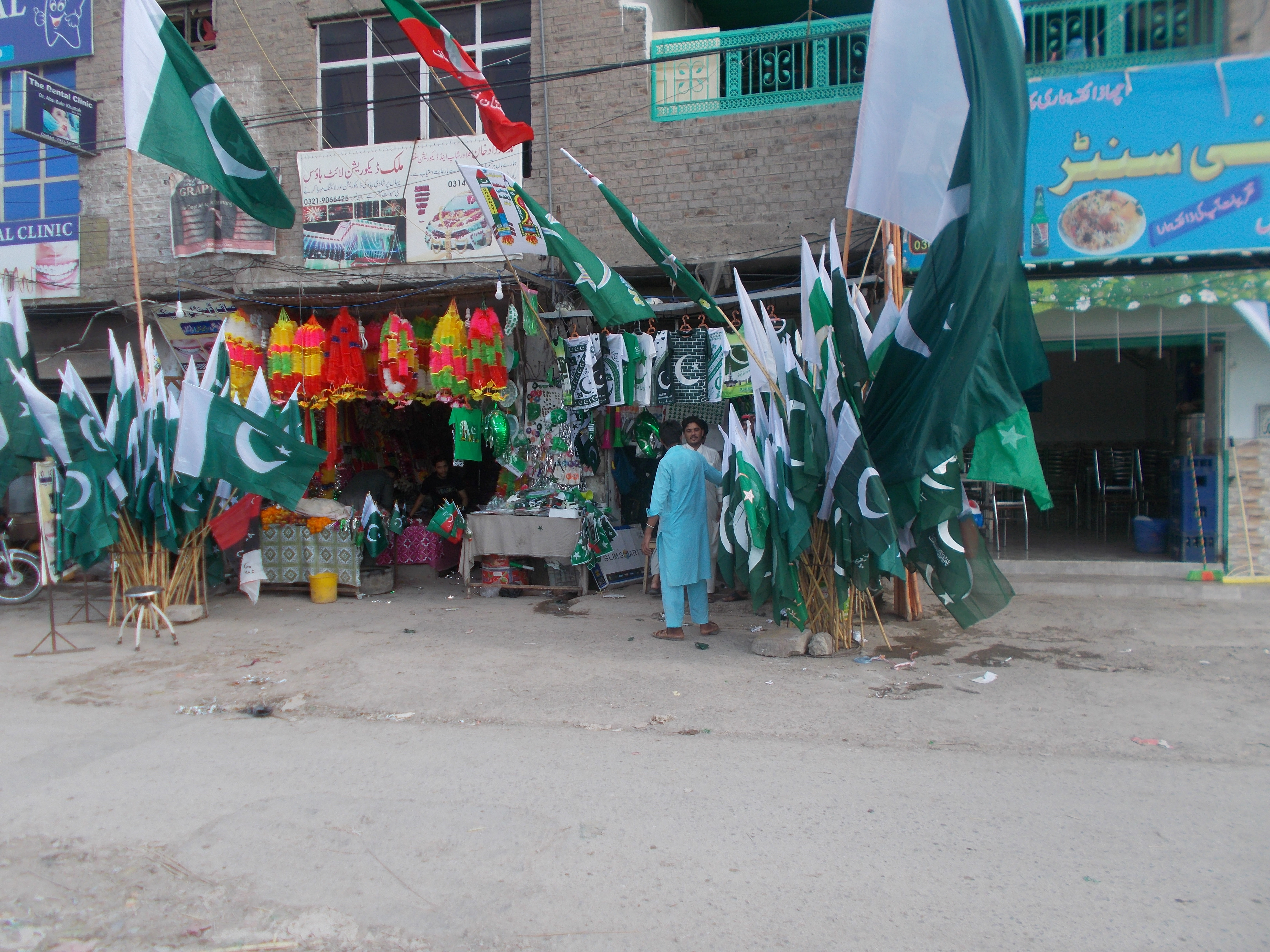 Business booms in Peshawar August 4 as shops offer flags and other souvenirs to celebrate Independence Day (August 14). [Ashfaq Yusufzai]