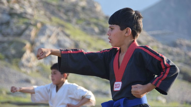 Schoolboys participate in a judo competition August 9 as part of the peace games organised by the FATA Secretariat. [Danish Yousafzai]
