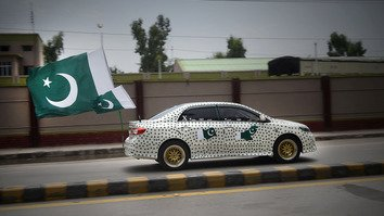 A Peshawar man drives his car decorated with national flags to celebrate Pakistan's Independence Day August 14. This year marked Pakistan's 70th anniversary of independence from Great Britain. Pakistan celebrates one day before India.
