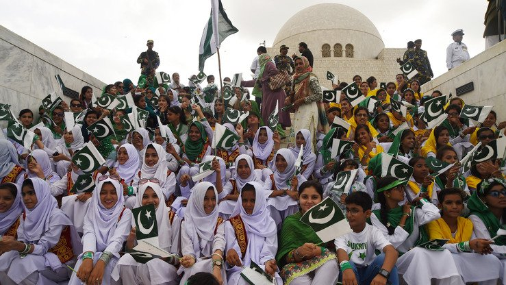 Pakistani students August 14 in Karachi hold national flags at the mausoleum of Pakistan's founder, Mohammad Ali Jinnah, to mark Independence Day. The country gained independence from Great Britain 70 years ago. [Asif Hassan/AFP]
