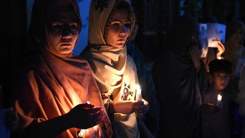 Pakistani women of the Hazara community light candles during a tribute ceremony in Quetta on July 24, 2016, a day after twin bombings tore through crowds of Shia Hazara protesters in Afghanistan. Women from Pakistan and Afghanistan are working together to fight a common enemy: terrorism and radicalism. [Banaras Khan/AFP]