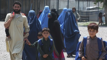 An Afghan family arrives at a centre in Peshawar for registration August 22. Pakistan August 16 launched a six-month-long drive to register 600,000 to 1 million undocumented Afghans nationwide. [Javed Khan]