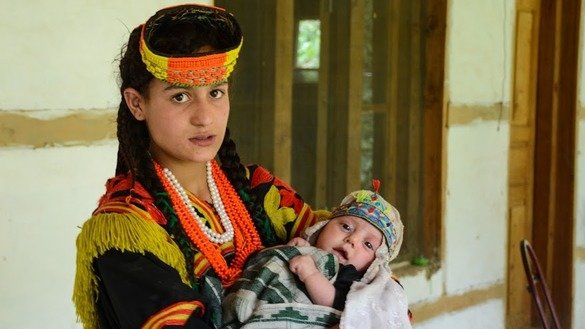 A Kalash mother holds her baby. [Alamgir Khan]