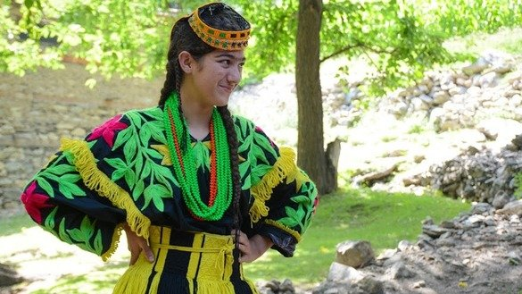 A Kalash woman poses in her traditional dress. [Alamgir Khan]
