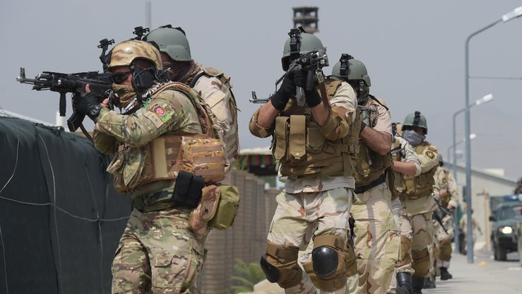 Afghan special forces perform a drill in Kabul July 27. Afghan commandos soon will take the front lines against the Taliban. [Shah Marai/AFP]