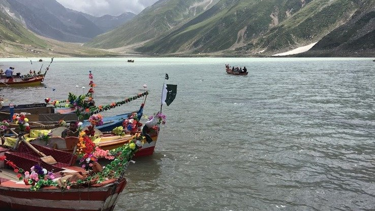 Boat owners wait for customers on Lake Saiful Muluk in August. [Qasim Yousafzai]