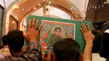 Mourners in Qom, Iran, carry a coffin of a Pakistani member of Zainabiyoun Brigade killed in battle in Syria. [File]