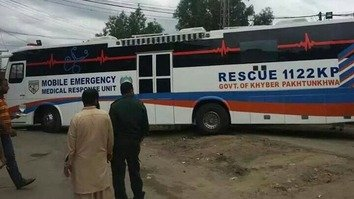 Khyber Pakhtunkhwa officials in Peshawar September 22 stand near the province's first Mobile Emergency Medical Response Unit. [Muhammad Ahil]