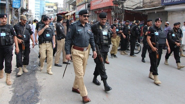 Senior Superintendent of Police Operations Peshawar Sajjad Khan (sunglasses) supervises security arrangements for Ashura processions in Peshawar September 30. [Peshawar Police]