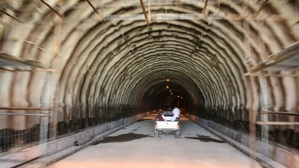 A car passes through the under-construction Nahakki Tunnel in 2016. [Alamgir Khan]