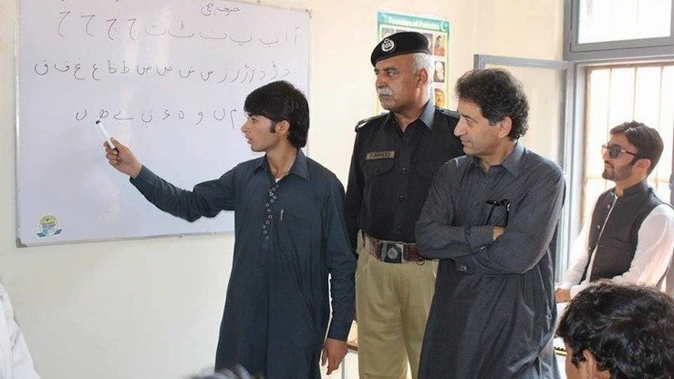 KP Education Minister Muhammad Atif Khan with prisoners at the inauguration ceremony in September of the Speed Literacy Programme at Mardan Central Jail. [KP Elementary and Secondary Education Department]