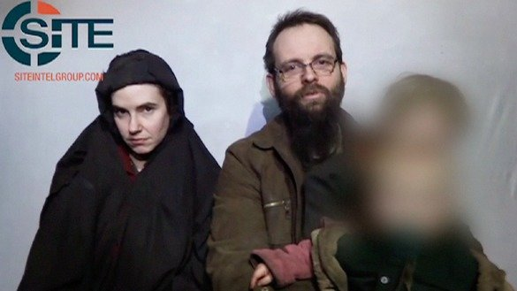 A still from a video released by militants last year, picturing Caitlan Coleman, Joshua Boyle and their son. [-- / SITE INTELLIGENCE GROUP / AFP]