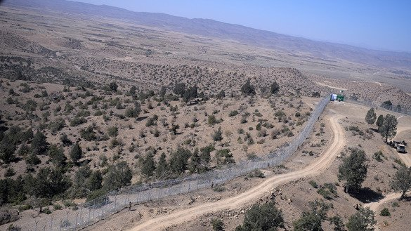 To date, workers have built 43km of fencing along the Pakistani-Afghan border. The entire border will be fenced by the end of 2018, according to Pakistani military officials. [Aamir Qureshi/AFP]