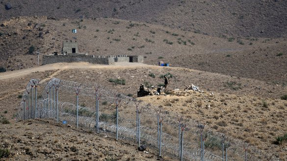 A Pakistani soldier keeps vigil along the newly fenced Pakistani-Afghan border at Kitton Orchard Post in North Waziristan October 18. [Aamir Qureshi/AFP]