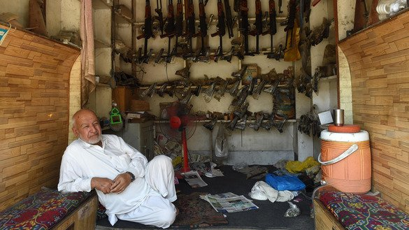 A Pakistani arms seller June 6, 2016, waits for customers in Dara Adamkhel, 35km south of Peshawar, in FATA. Authorities in KP recently opened a computerised arms license centre in Upper Dir District. [A Majeed/AFP]