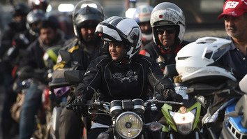 A Pakistani motorcyclist participating in the Pakistan Motor Rally leads other bikers in Islamabad October 23. [Farooq Naeem/AFP]