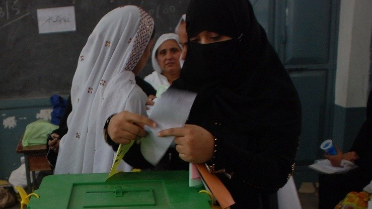 A woman casts her vote during by-polls in NA-4 Peshawar October 26. [Javed Khan]