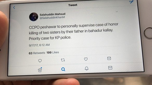 A user on an iPhone looks at a tweet from Khyber Pakhtunkhwa Inspector General of Police Salahuddin Khan Mehsud on November 8, 2017. [Pakistan Forward]
