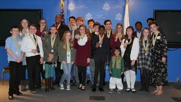 Esa Zaheer (front row) poses with other winners and runners-up of the Peace in the Streets Global Film Festival in New York November 9. [Courtesy of the Zaheer family]