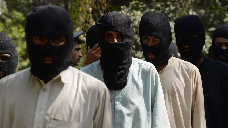 Alleged ISIS and Taliban fighters are presented to media in Jalalabad, Afghanistan, October 3. Afghan police said 10 alleged ISIS fighters, including two non-Afghans, and four Taliban militants were arrested during an operation in Nangarhar Province. [Noorullah Shirzada/AFP]