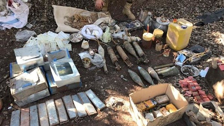 Pakistani security forces display recovered arms and ammunition found during a a counter-terror operation in Khyber Agency, the ISPR announced December 7, 2017. [ISPR]