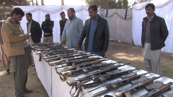 Pakistani security forces December 9 in Quetta inspect weapons surrendered by former militants from the Balochistan Liberation Army (BLA), Balochistan Liberation Front (BLF) and Baloch Republican Army (BRA) in Quetta. [Abdul Ghani Kakar]