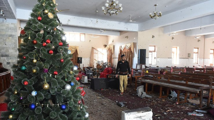 An investigator collects evidence December 18, a day after an ISIS suicide attack on Bethel Memorial Methodist Church in Quetta. [Banaras Khan/AFP]