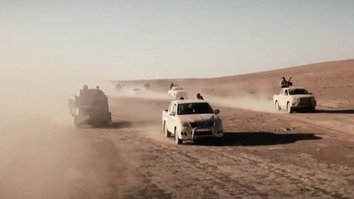 Screen shot from the 'Flames of War II' video from ISIS, using old footage of fighters driving across the group's so-called 'caliphate' before it collapsed this year.