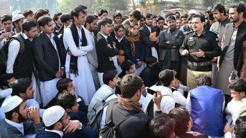 District Police Officer Mardan Mian Saeed Ahmad talks to students at a public college in Mardan November 25, as part of KP Police's efforts to raise awareness among youth about the dangers of drugs. [Javed Khan]