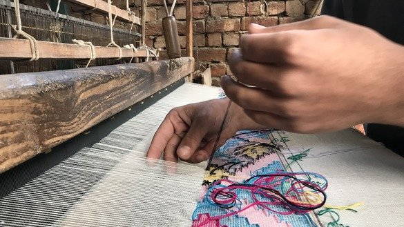 Local male and female artisans design creative patterns on shawls. Sometimes they spend weeks on a single shawl. [Danish Yousafzai]