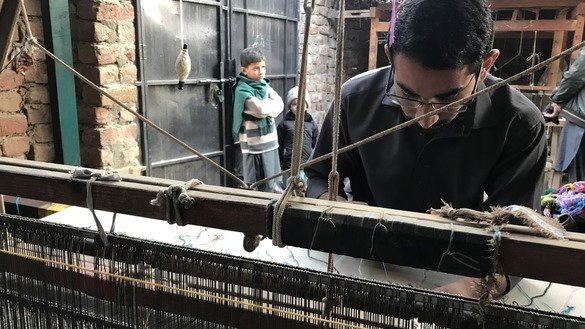 Hafeez ur Rahman, 21, is following in the footsteps of his parents in weaving shawls. He has become proficient at making high-quality shawls. [Danish Yousafzai]