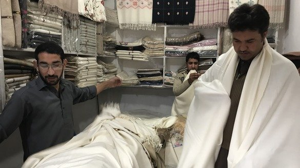 Besides making shawls for women, the artisans in Islampur make chaddars for men. Many tourists like these special shawls for men, vendors say. [Danish Yousafzai]