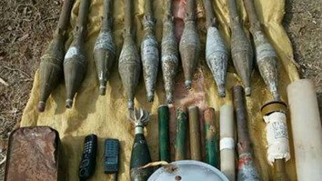 Rocket launchers, missiles, bullets, explosives, suicide vests and other equipment (shown in photo) were packed and sealed for years in mud in a tunnel in Orakzai Agency. [ISPR]