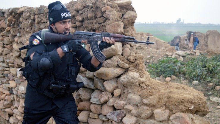 A KP Police commando carries out a counter-terrorism exercise in Swabi last October. Personnel of the highly trained Special Combat Unit recently carried out similar drills in Mardan and Peshawar. [Javed Khan]